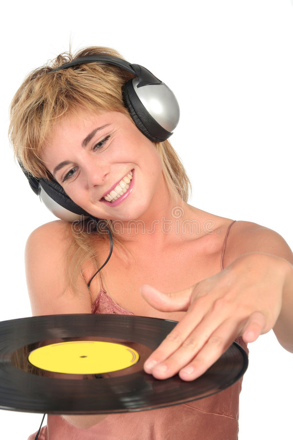 Female DJ Scratching Record. Young Female DJ Scratching Record royalty free stock image