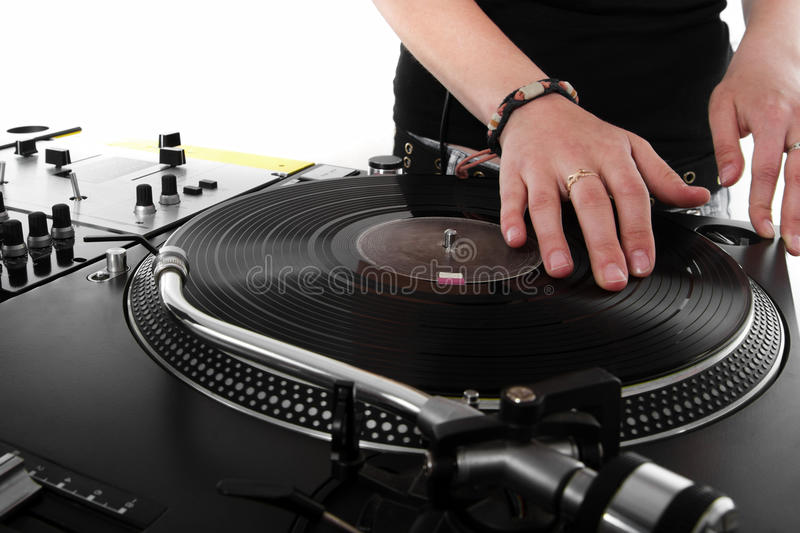 Female DJ scratching the vinyl record. Girl DJ playing hip-hop music on turntables stock photo