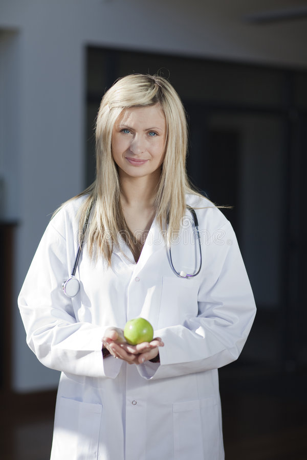 Download Female Doctor With An Apple In Her Hand Stock Image - Image: 8546693
