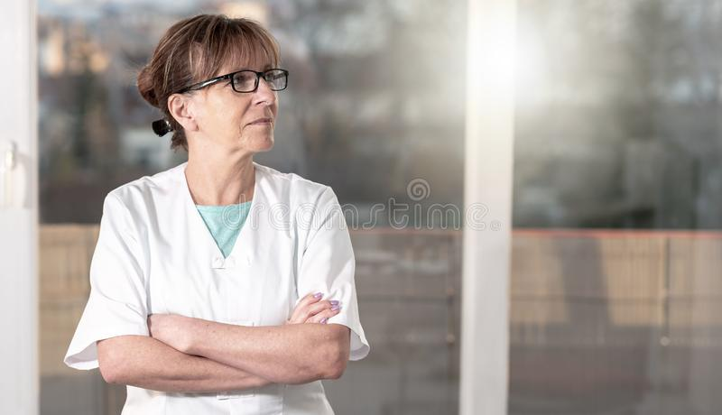 Female doctor with arms crossed royalty free stock photography