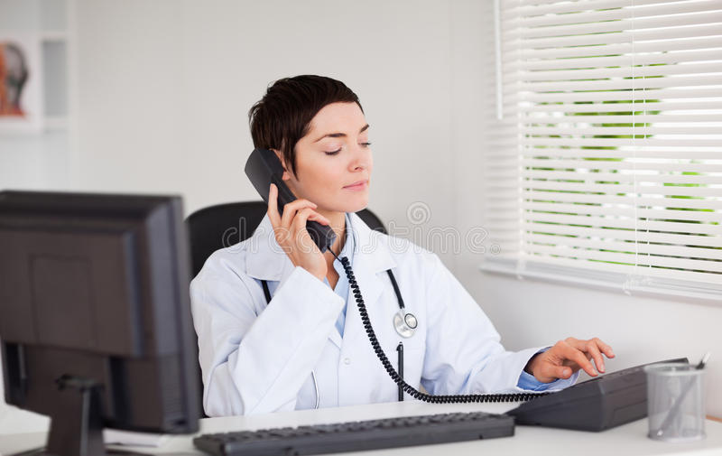 Download Female doctor calling stock photo. Image of physician - 20361566