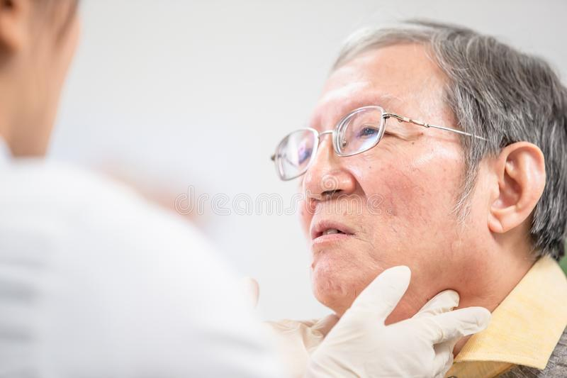 Female doctor check throat stock photo