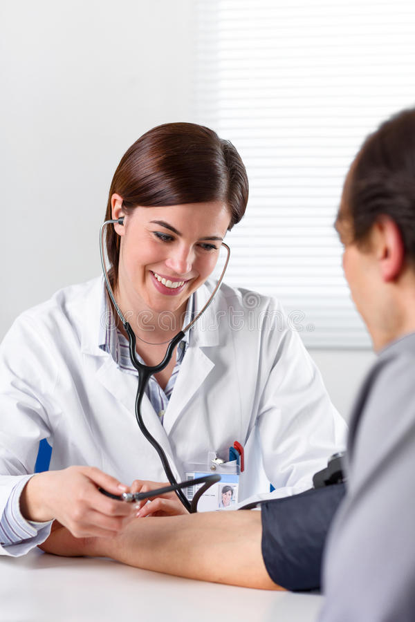 Female Doctor Checking Blood Pressure Of Patient royalty free stock photos