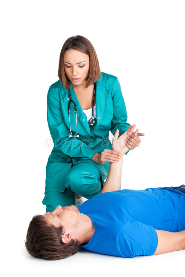 Female doctor checking patient heartbeat. stock image