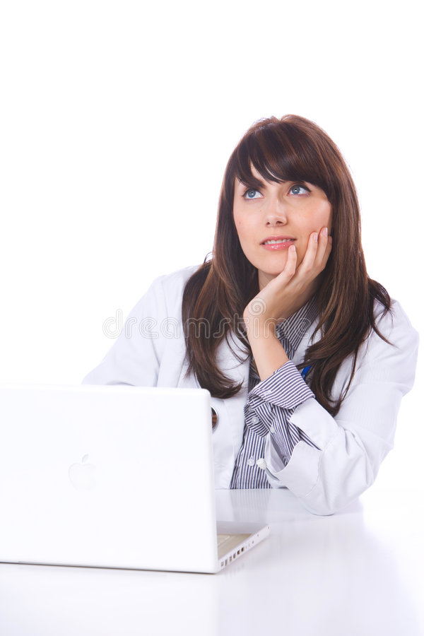 Female doctor on computer at desk royalty free stock image