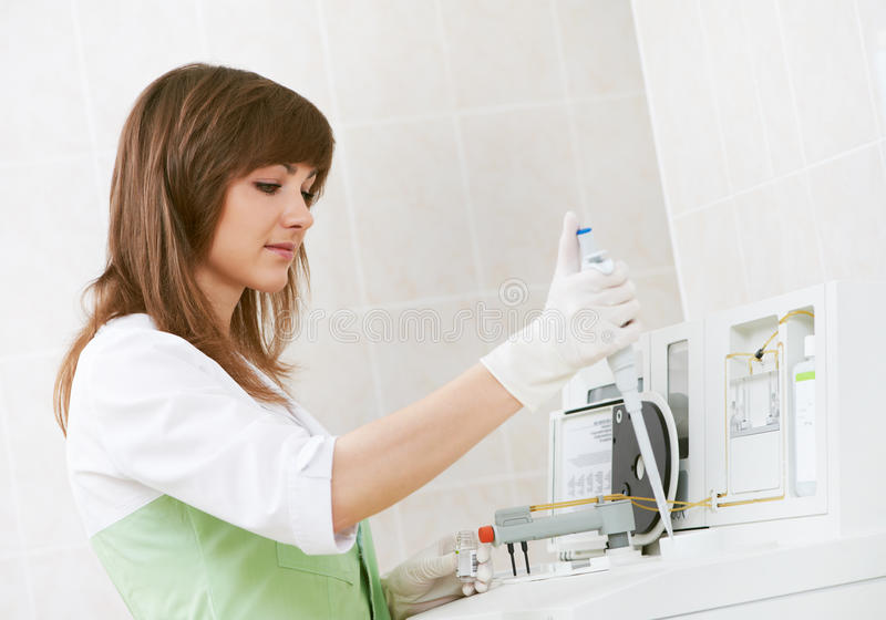 Download Female doctor with dropper stock image. Image of intern - 19839045