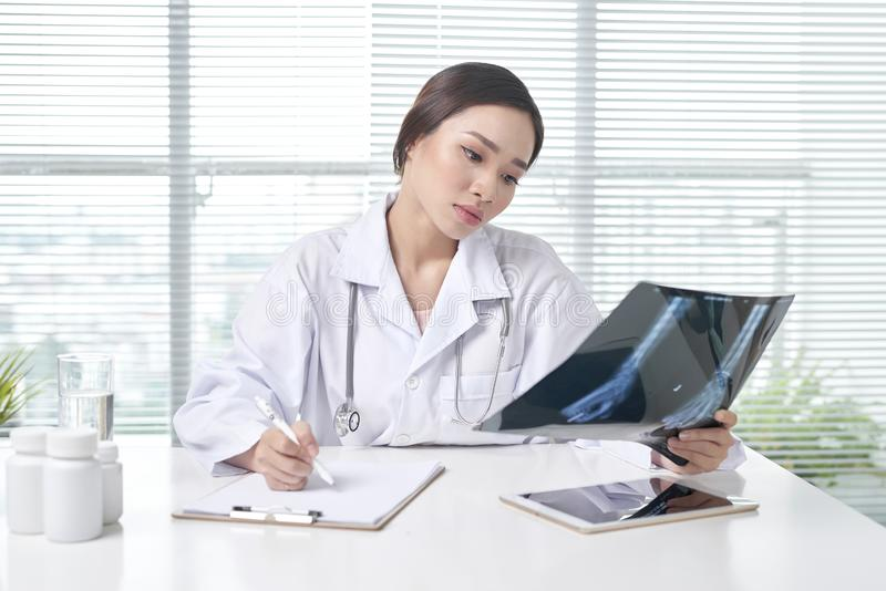 Female doctor is examined x-ray film royalty free stock photos