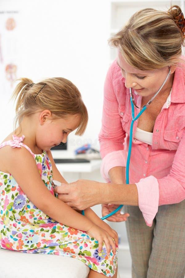 Female doctor examining child stock photos