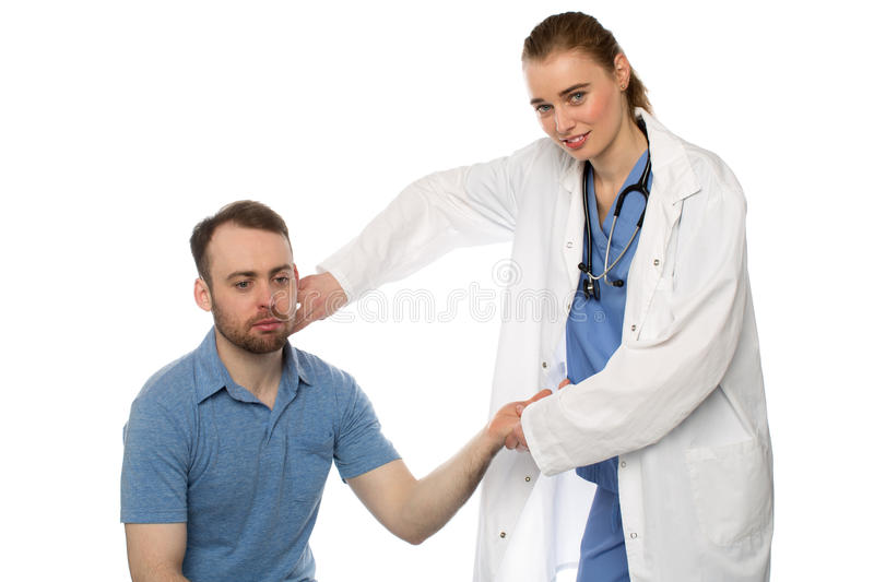 Female Doctor Examining Her Patient stock photos