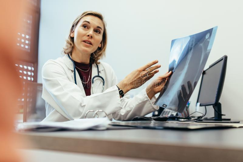 Doctor explaining checkup result to her patient stock image