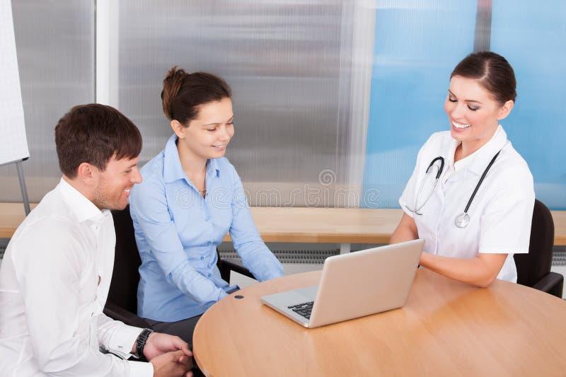 Female Doctor Explaining To Woman stock photo