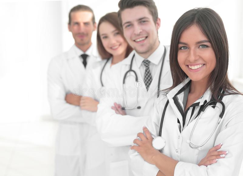 Female doctor with group of happy successful colleagues royalty free stock image