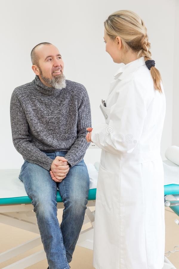 Female doctor is having a consultation. With a male patient in her office or private practice royalty free stock photography
