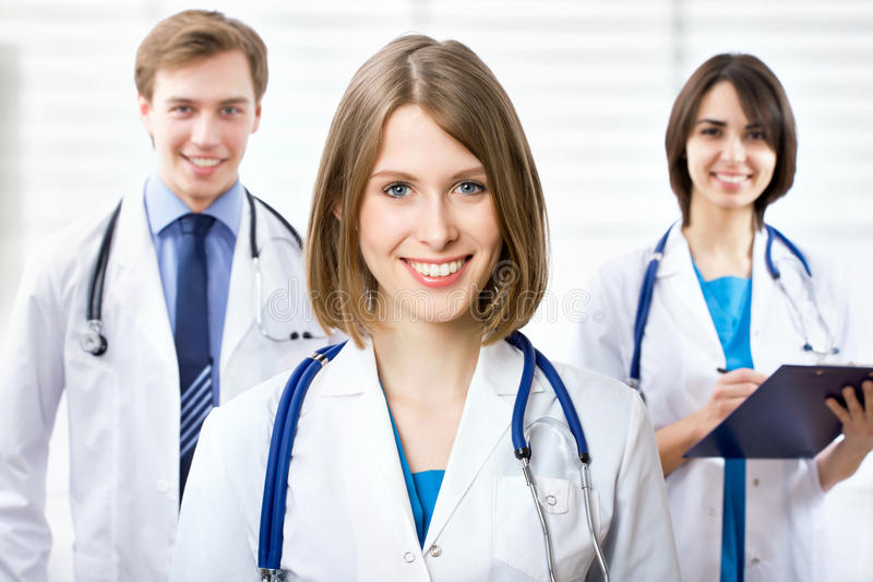 Female doctor and his team stock images
