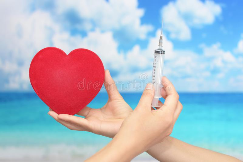 Female doctor holding injection needle. Close-up portrait of women hand with injection needle stock photos