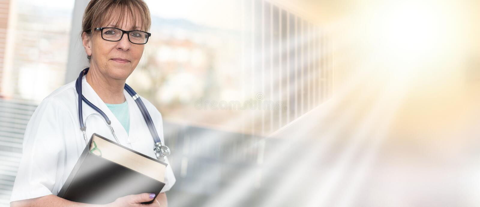 Female doctor holding a medical textbook; multiple exposure stock photos