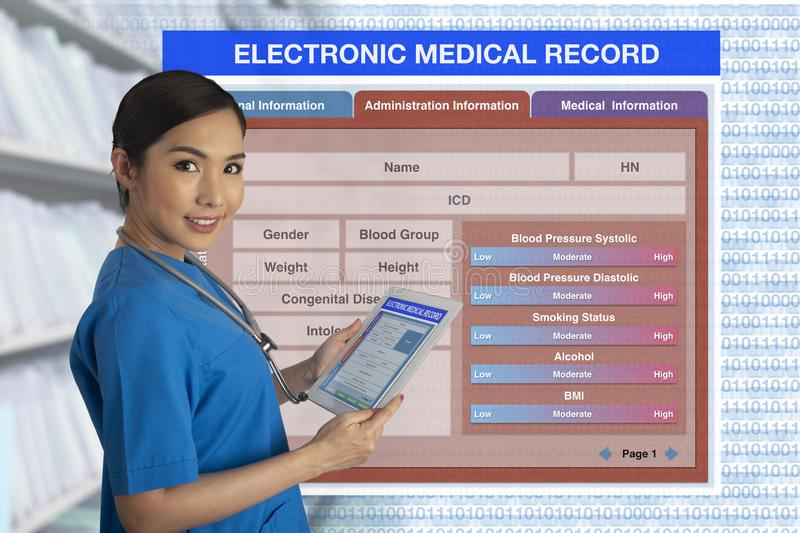 Female doctor holding tablet with blank electronic medical record form on background. stock photos