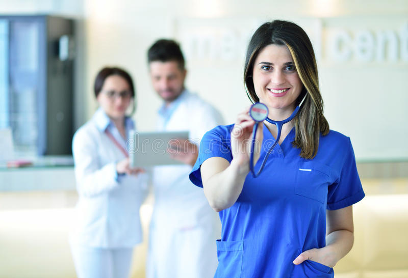 Female doctor leading a medical team at the hospital royalty free stock photo