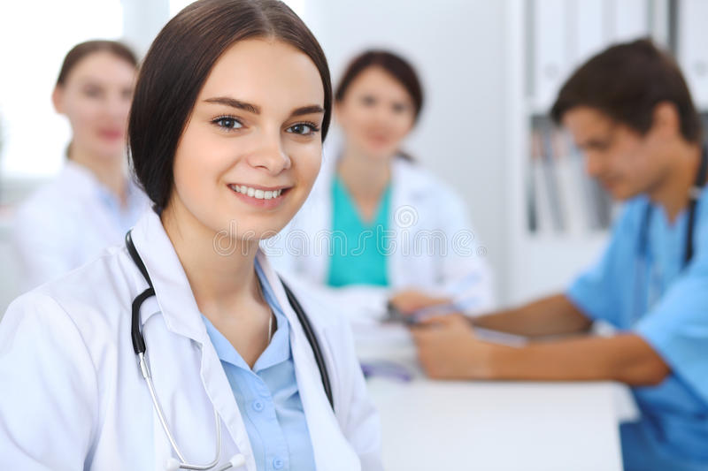 Female doctor leading a medical team at the hospital stock photography