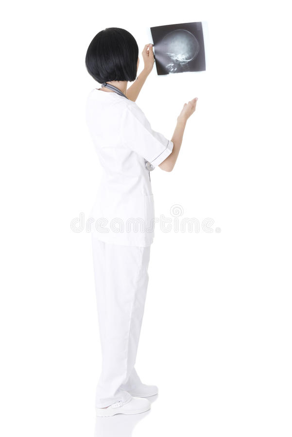 Female doctor looking at radiography photo. Female doctor or nurse looking at radiography photo stock photography