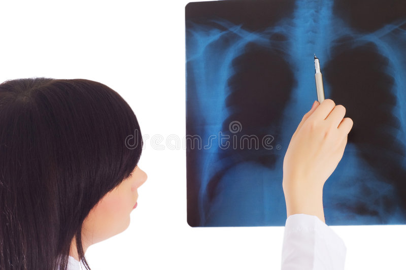 Female doctor looking at x-ray. Image on white royalty free stock photos