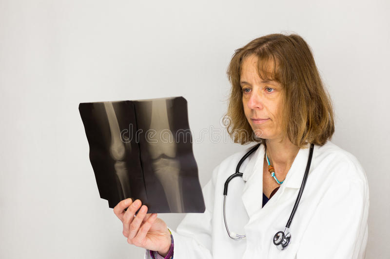 Female doctor looking at x-ray photo stock images