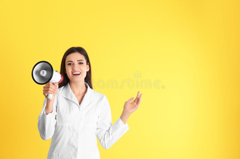 Female doctor with megaphone stock image
