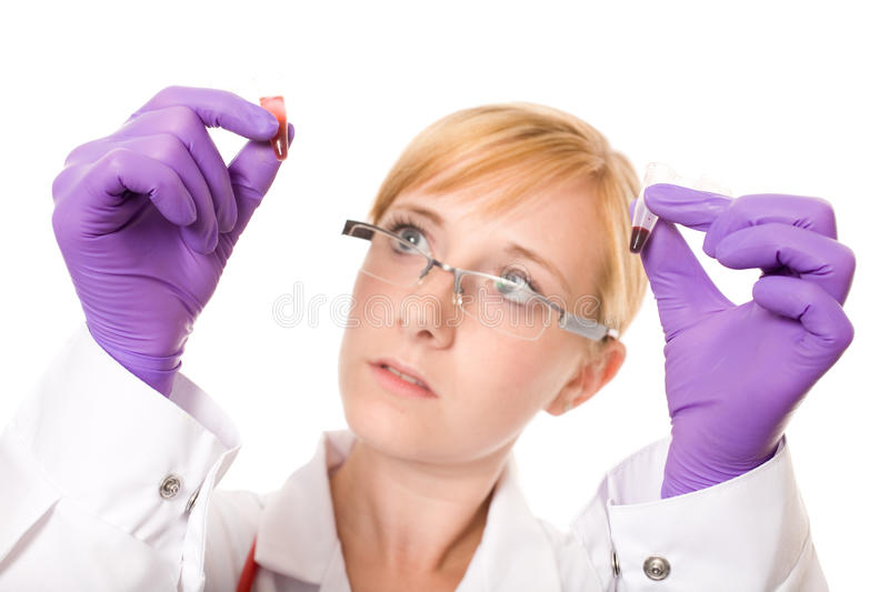 Female doctor or nurse compare two blood samples stock photos