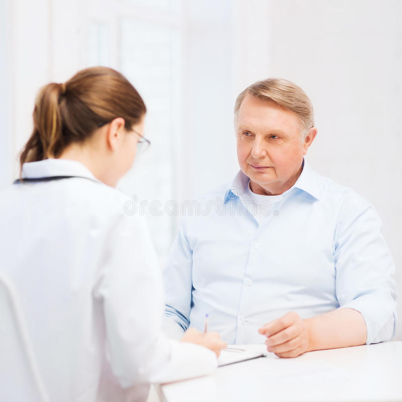 Download Female Doctor Or Nurse With Old Man Prescrbing Stock Photo - Image: 35563194