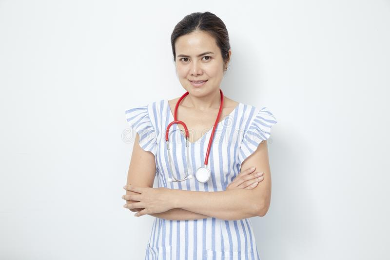 female doctor nurse with red stethoscope stock photo