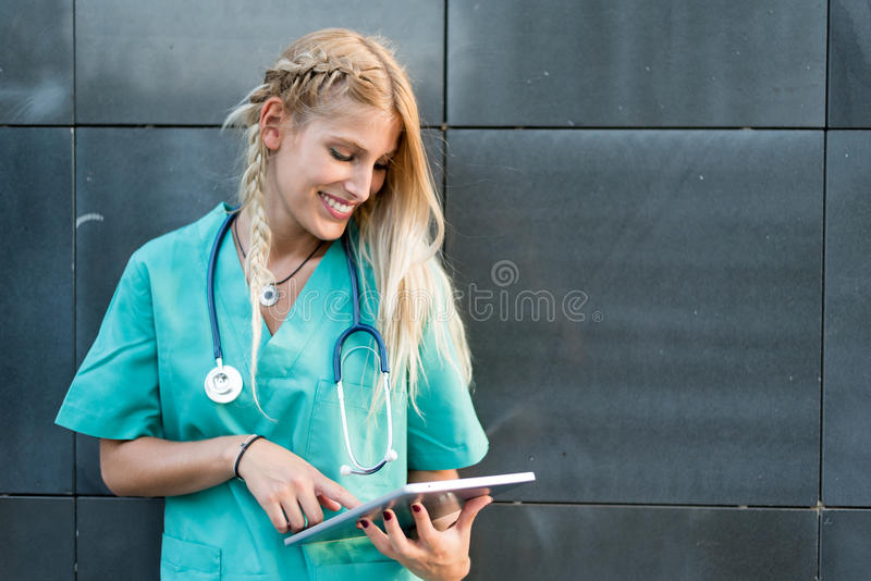 Female doctor, nurse or vet outdoors smiling looking at the came royalty free stock images