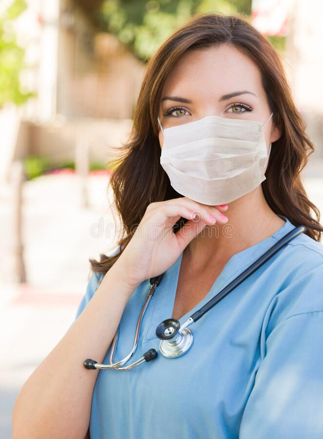 Female Doctor or Nurse Wearing Protective Face Mask stock photography