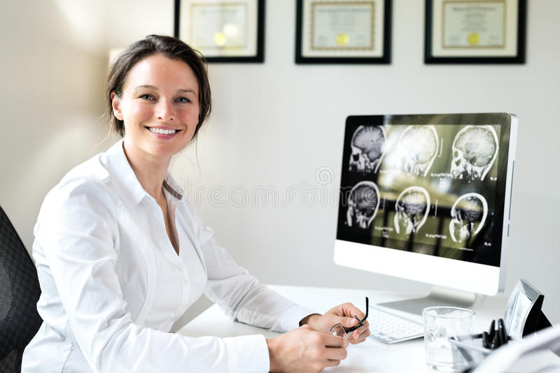 Female Doctor in Office. With Brain Scan royalty free stock photos