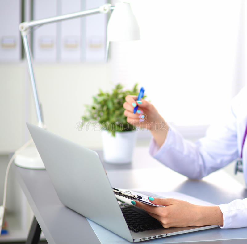 Female doctor at the office of the table.  stock image