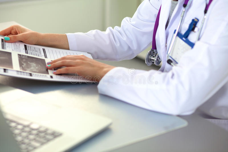 Female doctor at the office of the table.  stock photos