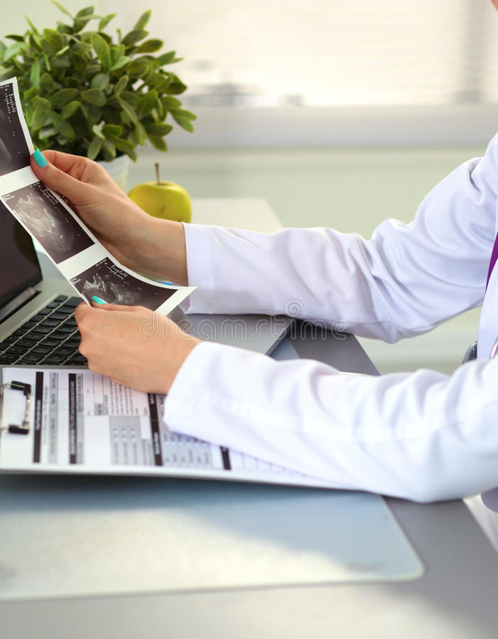 Female doctor at the office of the table.  royalty free stock photos