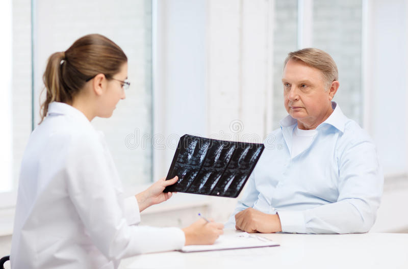 Download Female Doctor With Old Man Looking At X-ray Stock Photo - Image: 36736706