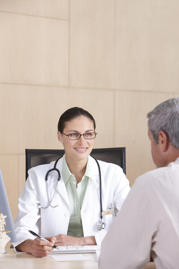 Download Female doctor and patient stock image. Image of mature - 10472431