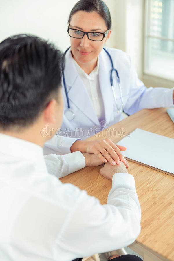 Female doctor and patient are consulting about health problem, D stock images