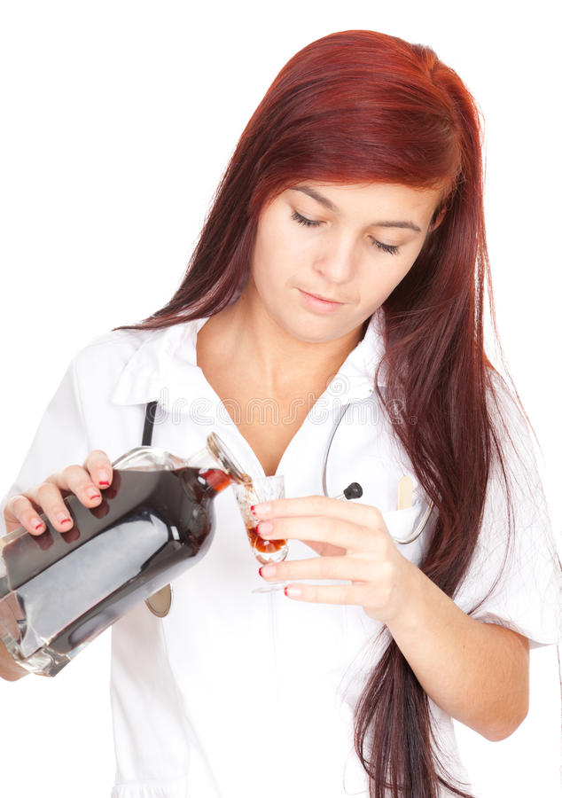 Female Doctor Pouring Syrup For Patient Royalty Free Stock Photography