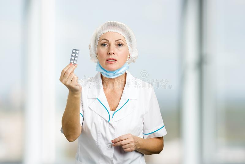 Female doctor prescribing medicine. royalty free stock photography