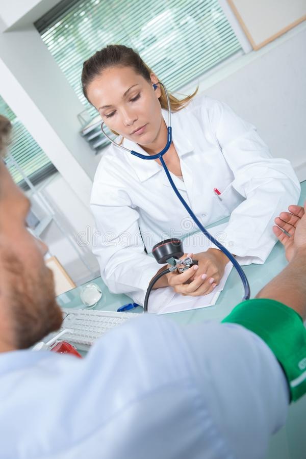 Female doctor with pressure gauge. Doctor stock images