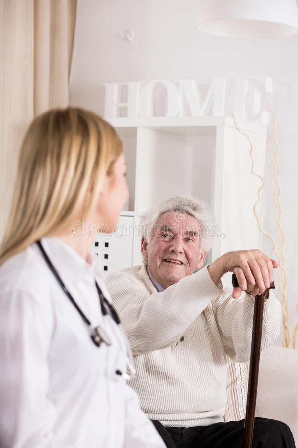 Female doctor during private visit. Image of female doctor during private visit at elderly patient stock image