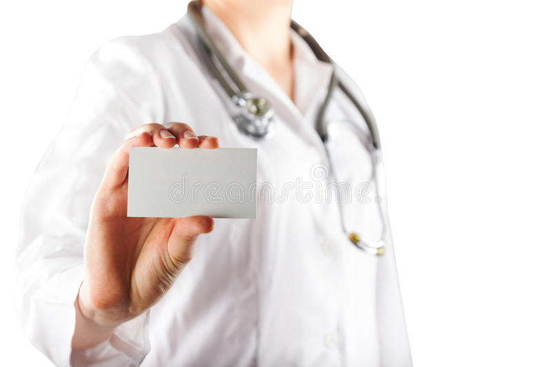 Female doctor's hand holding blank business card isolated on whi royalty free stock photography
