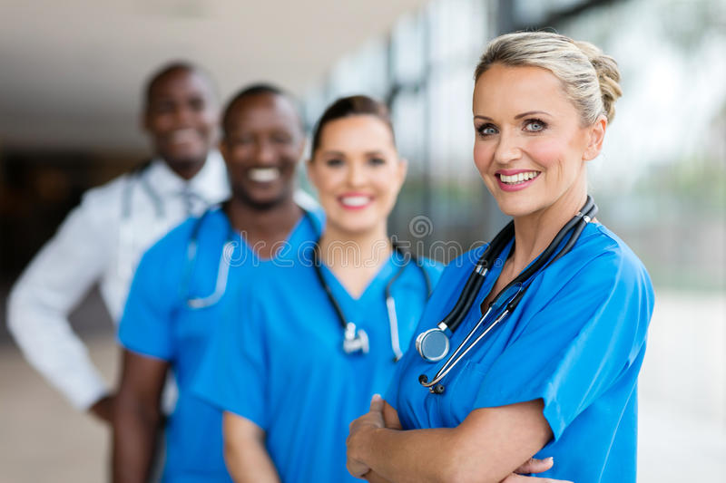 Female doctor standing team stock images