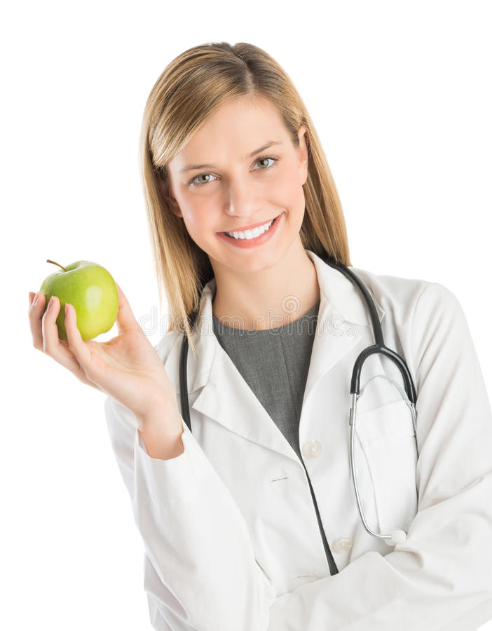 Female Doctor With Stethoscope Holding Granny Smith Apple stock image