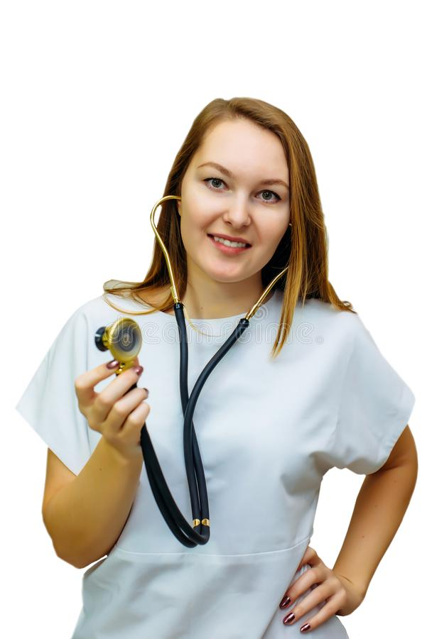 A female doctor with a stethoscope isolated on white background. Smiling doctor woman with stethoscope in hand. Beautiful young stock photo