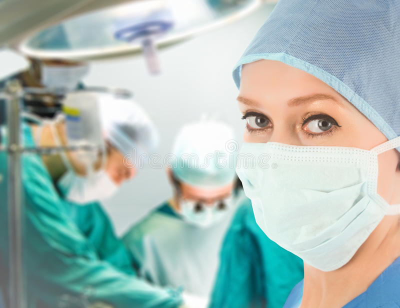 Female doctor with surgical team royalty free stock photos