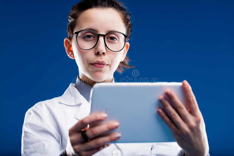 Female doctor with tablet royalty free stock images