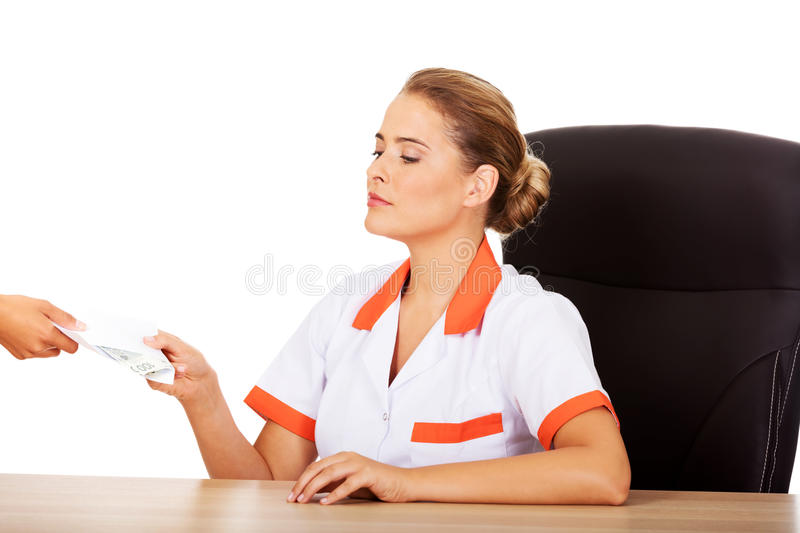 Female doctor take money from patient.  stock photography